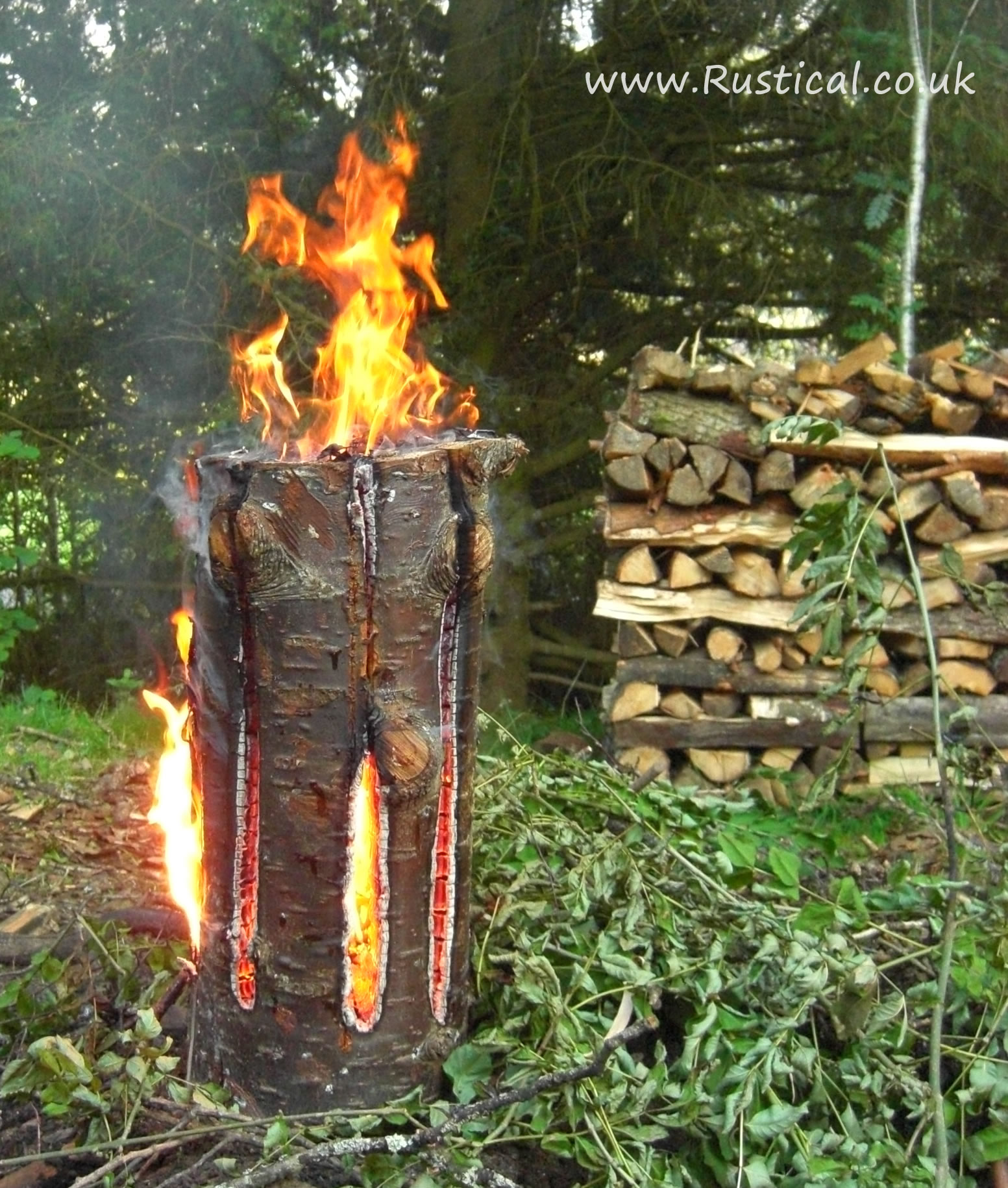 A lit 'Fire Dragon' Swedish Candle campfire alternative