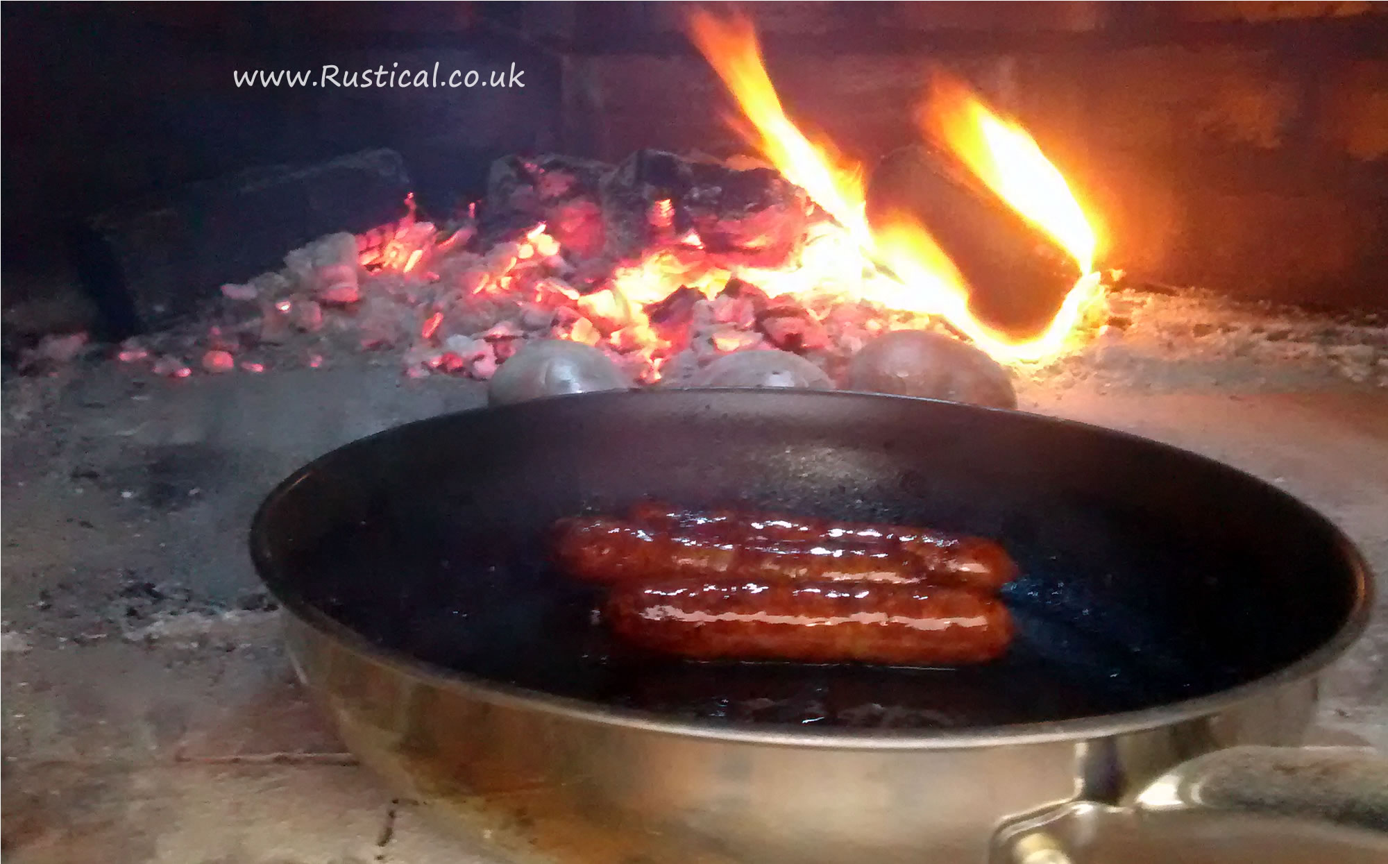 Cooking Sausages in a wood fired oven