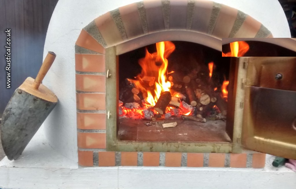 Our pizza oven loaded with wood chunks