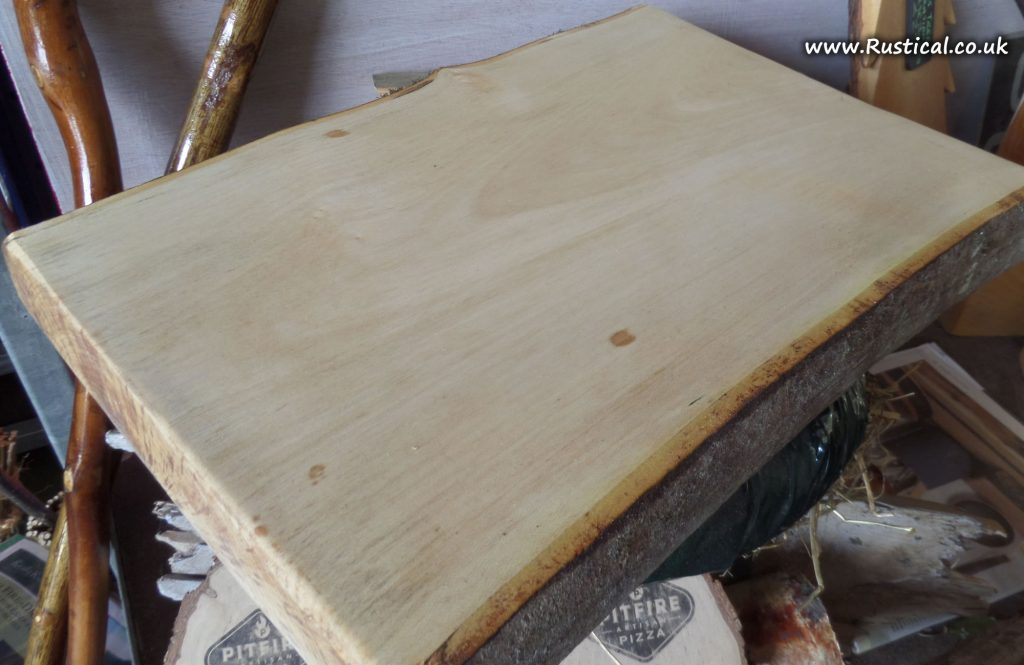 Large sycamore board gets its first oiling after sanding
