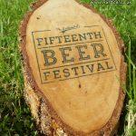 An event logo printed onto a birch log