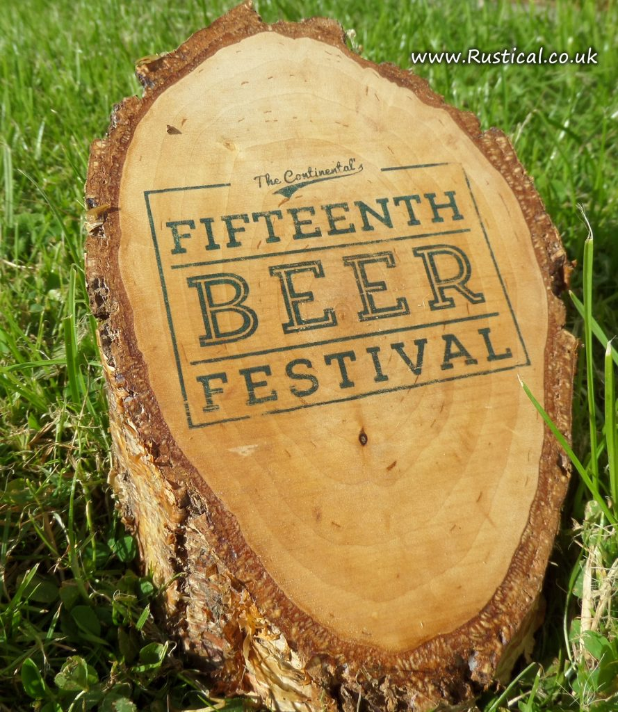An event logo printed onto a birch log
