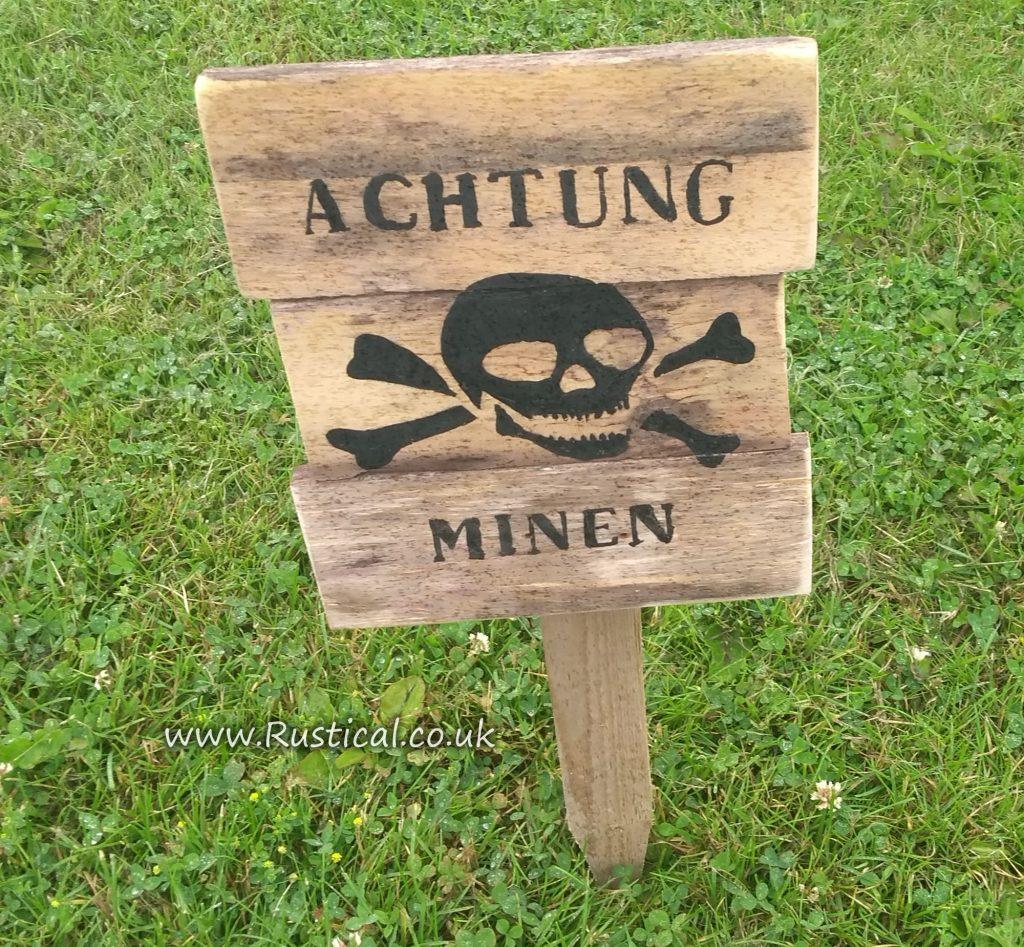 Wooden 'Achtung Minen' sign