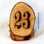 Branded rustic log table numbers