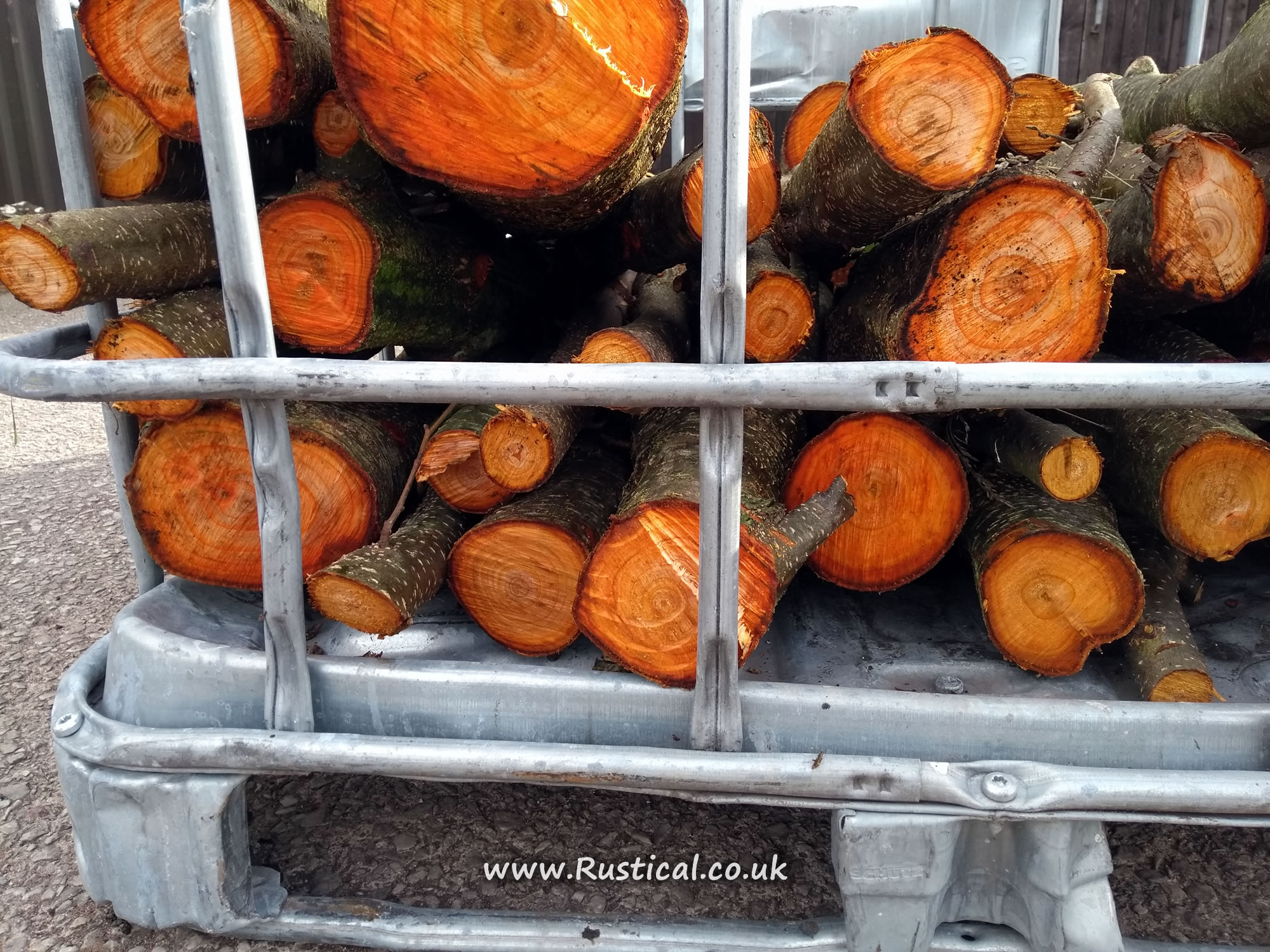 Coppiced Alder stacked in an IBC crate to season