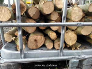 Coppiced Ash stacked in an IBC crate to season